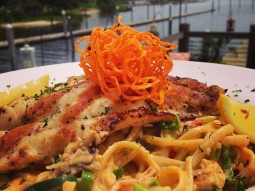 Grilled grouper over linguine pasta tossed in a garlic cream sauce with peppers, onions, shiitake mushrooms and scallions sprinkled with Parmesan cheese. #fishhousepensacola #goodeats #lunch