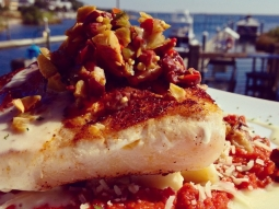 Blackened #grouper topped with an olive tapenade, served over #bacon, #potato, and arugula hash resting in a tomato basil sauce. #FishHousePensacola #seafood #yum #lunch #downtownpensacola