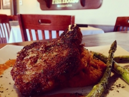 Walnut crusted #porkchop resting on a bed of butternut squash mash and grilled asparagus. #fishhousepensacola #lunch #foodporn #yum #upsideofflorida #downtownpensacola