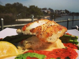 Seared snapper over Gouda grits resting in a fire roasted tomato and parsley coulis, served with a side of asparagus. #fishhousepensacola #lunch #snapper #seafood #foodporn #pensacola #florida #upsideofflorida #visitpensacola