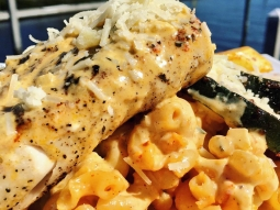 Today's special is blackened mahi over Cajun Mac and cheese served with grilled veggies