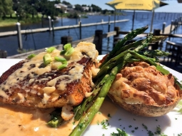 Perfect day in paradise! Let's eat! Today's special: ?Blackened mahi over pepper jack and bacon twice baked potato with grilled asparagus and finished with lobster fennel cream!