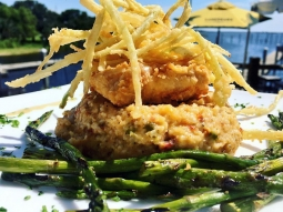 ?Chicken fried mahi over Acadia Gouda grits served with grilled asparagus and finished with crispy leek hay ?