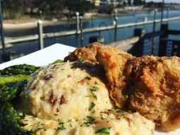It's FRIDAY! Treat yourself today, come eat lunch at The Fish House! Chicken fried mahi over pepperjack and bacon Gouda grits served with grilled asparagus and topped with meunière sauce.