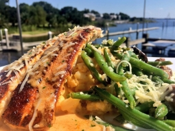 What a perfect day in paradise!!! Today's lunch special: ?Blackened mahi over lobster Mac and cheese served with sautéed green beans and mushrooms finished with blackened butter sauce. ?